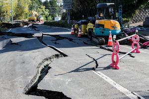KUMAMOTO, JAPAN - APRIL 16: The road is terriblly distructed by the earth quake on April 16, 2016 in Kumamoto, Japan. Following a 6.4 magnitude earthquake on April 14th, the Kumamoto prefecture was once again struck by a 7.3 magnitude earthquake, killing 9 people. (Photo by Taro Karibe/Getty Images)