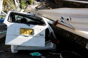 KUMAMOTO, JAPAN - APRIL 16: a crushed car is seen after a recent earthquake on April 16, 2016 in Kumamoto, Japan. Following a 6.4 magnitude earthquake on April 14th, the Kumamoto prefecture was once again struck by a 7.3 magnitude earthquake, killing 9 people. (Photo by Taro Karibe/Getty Images)