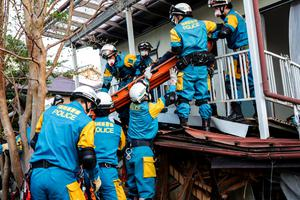 KUMAMOTO, JAPAN - APRIL 16: Rescue team saved a man from his house buried alive on April 16, 2016 in Kumamoto, Japan. Following a 6.4 magnitude earthquake on April 14th, the Kumamoto prefecture was once again struck by a 7.3 magnitude earthquake, killing 9 people. (Photo by Taro Karibe/Getty Images)