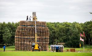 Masked men continue to build a bonfire at Inverary Playing Fields in Belfast. Police in Northern Ireland have warned their resources could be stretched amid growing fears of tension around the burning of Eleventh night bonfires. PRESS ASSOCIATION Photo. Picture date: Monday July 10, 2017. See PA story ULSTER Twelfth. Photo credit should read: PA Wire