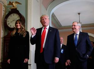 WASHINGTON, DC - NOVEMBER 10:  President-elect Donald Trump (C) talks to the media while joined by his wife Melania Trump, and Senate Majority Leader Mitch McConnell (R) after a meeting at the U.S. Capitol November 10, 2016 in Washington, DC. Earlier in the day president-elect Trump met with U.S. President Barack Obama at the White House.  (Photo by Mark Wilson/Getty Images)