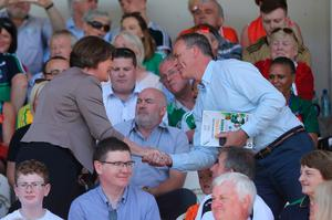 DUP Leader Arlene Foster and Minister of State at the Department of the Taoiseach Joe McHugh (right) at the Ulster final between Fermanagh and Donegal in Clones, Co Monaghan, Ireland. PRESS ASSOCIATION Photo. Picture date: Sunday June 24, 2018. Mrs Foster's attendance at a game synonymous with the nationalist tradition marks another symbolic milestone in cross-community engagement in the region. See PA story ULSTER Final. Photo credit should read: Niall Carson/PA Wire