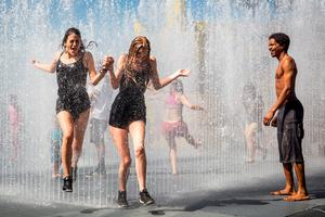 LONDON, ENGLAND - JUNE 30:  People cool off in a fountain outside the Southbank Centre on June 30, 2015 in London, England. The UK is currently experiencing a heatwave, with temperatures of 35 degree celsius forecast tomorrow in some parts of the country. The extreme heat has already seen train cancellations and a health warning has been issued. (Photo by Rob Stothard/Getty Images)