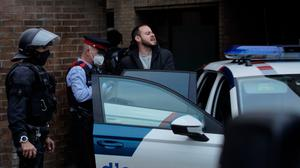 Rap singer Pablo Hasel is detained by police officers (Joan Mateu/AP)
