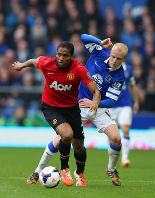 LIVERPOOL, ENGLAND - APRIL 20:  Luis Antonio Valencia of Manchester United is closed down by Steven Naismith of Everton during the Barclays Premier League match between Everton and Manchester United at Goodison Park on April 20, 2014 in Liverpool, England.  (Photo by Clive Brunskill/Getty Images)