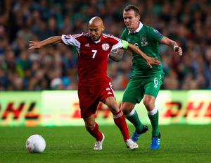 DUBLIN, IRELAND - SEPTEMBER 07:  Jaba Kankava of Georgia holds off Glenn Whelan of the Republic of Ireland during the UEFA EURO 2016 Group D qualifying match between Republic of Ireland and Georgia at Aviva Stadium on September 7, 2015 in Dublin, Ireland.  (Photo by Ian Walton/Getty Images)