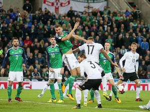 Press Eye Belfast - Northern Ireland 5th October 2017  FIFA World Cup Russia 2018 - Qualifying Group C - Northern Ireland Vs Germany at the National Football Stadium at Windsor Park, south Belfast.   Northern Ireland's Gareth McAuley goes up for a cross in the Germany box.   Picture by Jonathan Porter/PressEye.com