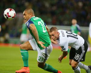 Press Eye Belfast - Northern Ireland 5th October 2017  FIFA World Cup Russia 2018 - Qualifying Group C - Northern Ireland Vs Germany at the National Football Stadium at Windsor Park, south Belfast.   Northern Ireland's Josh Magennis with Germany's Joshua Kimmich.   Picture by Jonathan Porter/PressEye.com