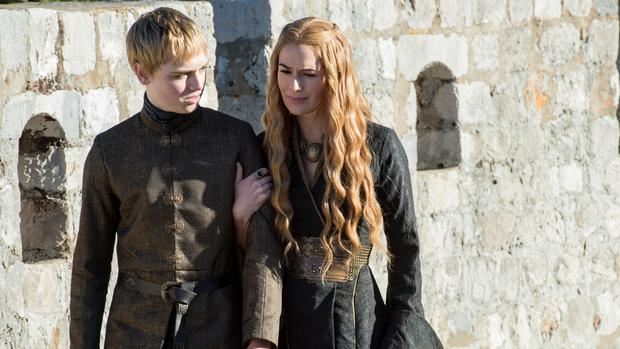 Dean-Charles Chapman as Tommen Baratheon and Lena Headey as Cersei Lannister. Photo Credit: Macall B. Polay/HBO