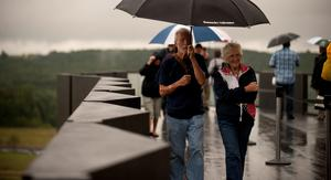 SHANKSVILLE, PA - SEPTEMBER 10: Family members and dignitaries brave the rain at the visitor center at the Flight 93 National Memorial on September 10, 2015 in Shanksville, Pennsylvania. The newly opened $26 million visitor center complex was dedicated in honor of the victims of Flight 93 on the evening of the 14th anniversary of the 9/11 attacks. (Photo by Jeff Swensen/Getty Images)