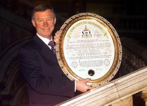 File photo dated 08/11/1999 of Manchester United manager Sir Alex Ferguson, holds up the plaque as he receives the freedom of the City of Glasgow. PRESS ASSOCITAION Photo. Issue date: Wednesday May 8, 2013. Sir Alex Ferguson will retire at the end of this season, Manchester United have announced. See PA Story SOCCER Man Utd. Photo credit should read: Ben Curtis/PA Wire.
