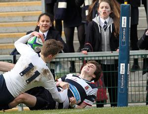 @Press Eye Ltd Northern Ireland- 5th March   2015 Mandatory Credit -Brian Little/Presseye  Methodist College Conor Kelly scores a try while tackled by  Wallace High School Philip Hylands     during Thursday's Ulster School's Cup semi final at Kingspan Stadium, Belfast. Picture by Brian Little/ Presseye