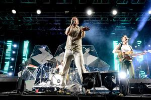 INDIO, CA - APRIL 13:  Yeasayer performs onstage during day 2 of the 2013 Coachella Valley Music & Arts Festival at The Empire Polo Club on April 13, 2013 in Indio, California.  (Photo by Frazer Harrison/Getty Images for Coachella)