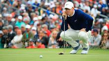 Green for go: Rory McIlroy lines up a putt on the third green at Pebble Beach