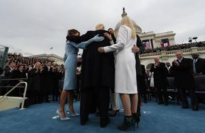 WASHINGTON, DC - JANUARY 20:  U.S. President Donald Trump embraces his family after taking the oath of office during inauguration ceremonies swearing in Trump as the 45th president of the United States on the West front of the U.S. Capitol in Washington, DC, U.S., January 20, 2017.  (Photo by Jim Bourg - Pool/Getty Images)
