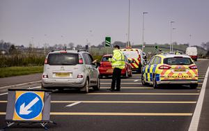 Police officers set up a checkpoint on the Frosses Road heading towards Portrush as the coronavirus pandemic continues in Northern Ireland on April 10th 2020 (Photo by Kevin Scott for Belfast Telegraph)