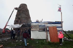 "An bonfire under construction in the Ballymacash area of Lisburn, as building continues on huge loyalist bonfires, which are traditionally lit on the ""Eleventh night"" to usher in the Twelfth commemorations. PRESS ASSOCIATION Photo. Picture date: Sunday July 10, 2016. Authorities in Northern Ireland are cautiously optimistic the main fixture in the loyal order parading season can pass off peacefully, but have a major policing operation planned to deal with any unrest. See PA story ULSTER Twelfth. Photo credit should read: Brian Lawless/PA Wire"
