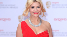 Holly Willoughby arriving for the 2013 Arqiva British Academy Television Awards at the Royal Festival Hall, London. PRESS ASSOCIATION Photo. Picture date: Sunday May 12, 2013. See PA story SHOWBIZ Bafta. Photo credit should read: Dominic Lipinski/PA Wire