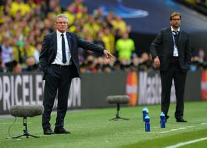 LONDON, ENGLAND - MAY 25:  Head Coach Jupp Heynckes of Bayern Muenchen (L) and Head Coach Jurgen Klopp of Borussia Dortmund gesture during the UEFA Champions League final match between Borussia Dortmund and FC Bayern Muenchen at Wembley Stadium on May 25, 2013 in London, United Kingdom.  (Photo by Shaun Botterill/Getty Images)