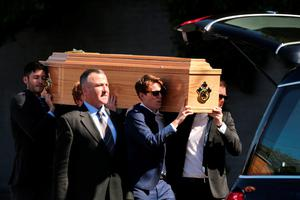 The coffin of Eoghan Culligan is carried during his funeral at the Church of the Annunciation, Rathfarnham in Dublin, after he died when a balcony collapsed in the college town of Berkeley, California. PRESS ASSOCIATION Photo. Picture date: Tuesday June 23, 2015. See PA story FUNERAL Balcony. Photo credit should read: Niall Carson/PA Wire