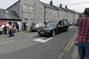 Funeral of past UTV Presenter Brian Black as it passes through his home town of Strangford on its way to  Roselawn cemetery in Belfast. Photo by Stephen Hamilton/Presseye