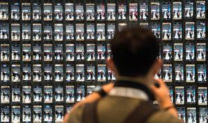 Visitor takes a picture of numerous Samsung Galaxy S6 edge smartphones at the booth of South Korean electronics giant Samsung ahead of the opening of the 55th IFA (Internationale Funkausstellung) electronics trade fair in Berlin on September 3, 2015. IFA, Europe's largest consumer electronics and home appliances fair opens from September 4 to September 9, 2015. AFP PHOTO / JOHN MACDOUGALLJOHN MACDOUGALL/AFP/Getty Images