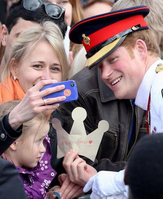 GETTY IMAGES ROYAL PHOTOGRAPHER OF THE YEAR FINALIST  A member of the public takes a 'selfie' with Prince Harry as he meets locals in Freedom Square on May 16, 2014 in Tallinn, Estonia. Picture: Chris Jackson/Getty Images