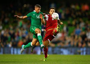 DUBLIN, IRELAND - SEPTEMBER 07:  Aleksandr Amisulashvili of Georgia clears the ball from Jonathan Walters of the Republic of Ireland during the UEFA EURO 2016 Group D qualifying match between Republic of Ireland and Georgia at Aviva Stadium on September 7, 2015 in Dublin, Ireland.  (Photo by Ian Walton/Getty Images)
