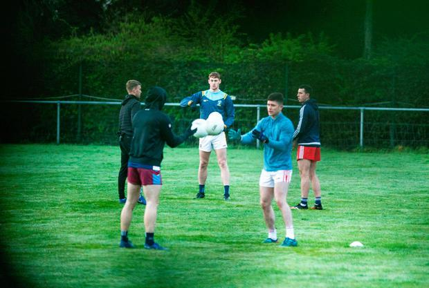 Off the ball: Dublin squad members go through their places at Malahide in defiance of the current collective training ban
