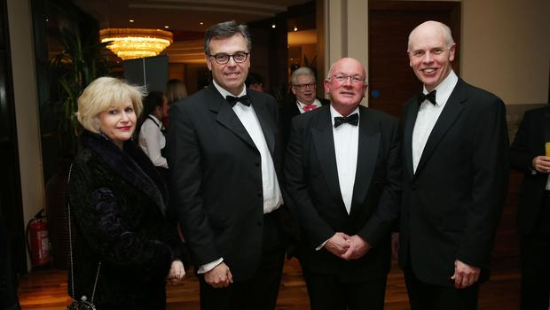 Maura Quinn, Alistair Hamilton, Peter Martin and Frank Bryan at the Institute of Directors NI Annual Dinner at the Europa Hotel on Thursday night. Sponsored by Bank of Ireland and Arthur Cox, the event is the highlight of the local business calendar and was attended by over 250 people.  Picture by Kelvin Boyes / Press Eye.