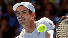 Marching on: Andy Murray makes a backhand return to Sam Querrey in Melbourne yesterday but compatriot Dan Evans is stealing his thunder