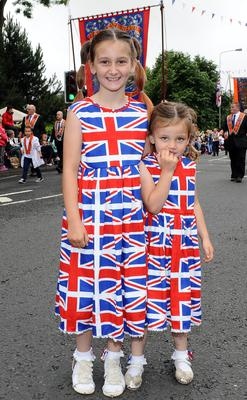 PACEMAKER BELFAST  13/07/2015 12th July celebrations in Derriaght/Dunmurry today Sisters Amy and Katie Cairns from Lisburn add a bit of colour to todays parade at Seymore Hill
