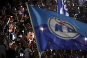 Kyriakos Mitsotakis celebrates with supporters (Thanassis Stavrakis/AP)
