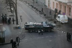 Police block the way with an armored personnel carrier at the Ukraine's parliament in Kiev, Ukraine, Thursday, Feb. 20, 2014. Ferocious street battles between protesters and police in the Ukrainian capital have left dozens dead and hundreds wounded in the past few days, raising fears that the ex-Soviet nation, whose loyalties are split between Russia and the West, is in an uncontrollable spiral of violence.(AP Photo/Petro Zadorozhnyy)