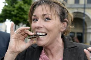 Bugs yummy: Collette Reynolds gets stuck into a large water beetle
