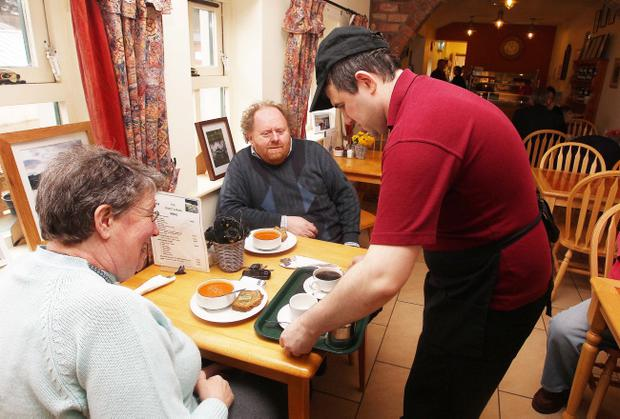 Leading mental health charity Praxis is set to be evicted from Hillsborough Castle.  The local charity rents a coffee shop and garden area of the NIO and employees 16 people with learning difficulties.  Andrew Webb serves customers in the cafe.