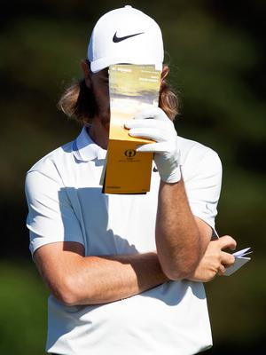 England's Tommy Fleetwood checks his course notes during a practice session at The 148th Open golf Championship at Royal Portrush golf club in Northern Ireland on July 14, 2019. (Photo by Andy Buchanan / AFP) / RESTRICTED TO EDITORIAL USEANDY BUCHANAN/AFP/Getty Images