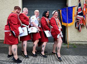 BELFAST, NORTHERN IRELAND - JULY 12: Female Orange lodge members show off their matching tattoos before taking part in the annual Orange march on July 12, 2016 in Belfast, Northern Ireland. The Orange marches and demonstrations celebrate the Battle of the Boyne in 1690 when the Protestant King William of Orange defeated the Catholic King James II on the banks of the river Boyne. (Photo by Charles McQuillan/Getty Images)