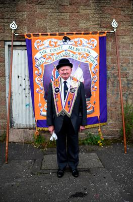 BELFAST, NORTHERN IRELAND - JULY 12: An Orangeman poses for a portrait before he takes part in the annual Orange march on July 12, 2016 in Belfast, Northern Ireland. The Orange marches and demonstrations celebrate the Battle of the Boyne in 1690 when the Protestant King William of Orange defeated the Catholic King James II on the banks of the river Boyne. (Photo by Charles McQuillan/Getty Images)