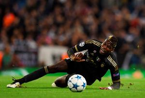 Juventus' midfielder from France Paul Pogba is tackled by Manchester City's Ivorian midfielder Yaya Toure during a UEFA Champions League group stage football match between Manchester City and Juventus at the Etihad stadium in Manchester, north-west England on September 15, 2015.    AFP PHOTO / PAUL ELLISPAUL ELLIS/AFP/Getty Images