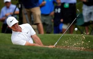 Rory McIlroy, of Northern Ireland, hits out of the bunker on the second hole during a practice round for the PGA Championship golf tournament at Valhalla Golf Club on Tuesday, Aug. 5, 2014, in Louisville, Ky. The tournament is set to begin on Thursday. (AP Photo/Mike Groll)