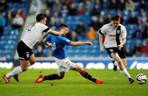 Rangers' Fraser Aird and Ayr United's Michael McGowan battle for the ball during the Scottish League One match at Ibrox, Glasgow.