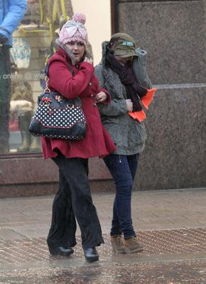 Shoppers battle through the horrendous weather conditions in Belfast city centre. Photograph:Stephen Hamilton /Presseye