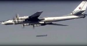 In this photo made from the footage taken from Russian Defense Ministry official web site on Tuesday, Nov. 17, 2015, a Russian Tu-95 bomber launches a cruise missile at a target in Syria. Russia's defense minister said its warplanes have fired cruise missiles on militant positions in Syria's Idlib and Aleppo provinces. The Islamic State group has positions in Aleppo province; Idlib has the presence of the Nusra militant group.  (AP Photo/ Russian Defense Ministry Press Service)