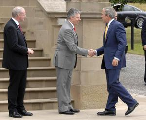 Sinn Fein Deputy First Minister Martin McGuinness, left and First Minister Peter Robinson, centre, greet US President George Bush, right, to the Stormont Castle in Belfast on the second day of the President's official visit to the UK. PRESS ASSOCIATION Photo. Picture date: Monday June 16, 2008. US president George Bush arrived in Northern Ireland today to meet the politicians heading its power-sharing government. Democratic Unionist First Minister Peter Robinson and Sinn Fein Deputy First Minister Martin McGuinness will welcome the president and the First Lady at Stormont Castle in Belfast. See PA story POLITICS Bush. Photo credit should read: Stephen Wilson/PA Wire