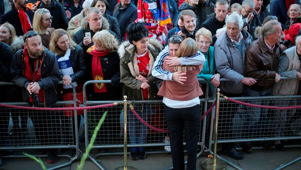 LIVERPOOL, ENGLAND - APRIL 27:  Margaret Aspinall is hugged by members of the public as thousands gather outside Liverpool's Saint George's Hall as they attend a vigil for the 96 victims of the Hillsborough tragedy on April 27, 2016 in Liverpool, England. The civic commemoration event marks the outcome of the fresh inquests into the 1989 Hillsborough disaster, in which 96 football supporters were crushed to death, and concluded yesterday with a verdict of unlawful killing. Relatives, Liverpool supporters and members of the public are taking part in the vigil at St George's Hall where a candle is lit for each of the 96 victims who lost their lives during a crush at the Hillsborough football ground in Sheffield, South Yorkshire in 1989..  (Photo by Christopher Furlong/Getty Images)