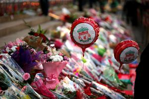 LIVERPOOL, ENGLAND - APRIL 27:  Tributes are left outside Liverpool's Saint George's Hall as thousands of people gather to attend a vigil for the 96 victims of the Hillsborough tragedy on April 27, 2016 in Liverpool, England. The civic commemoration event marks the outcome of the fresh inquests into the 1989 Hillsborough disaster, in which 96 football supporters were crushed to death, and concluded yesterday with a verdict of unlawful killing. Relatives, Liverpool supporters and members of the public are taking part in the vigil at St George's Hall where a candle is lit for each of the 96 victims who lost their lives during a crush at the Hillsborough football ground in Sheffield, South Yorkshire in 1989..  (Photo by Christopher Furlong/Getty Images)