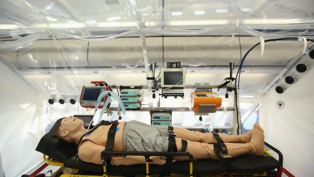 A mannequin lies in the isolation unit of a retrofitted Lufthansa plane equipped with medical facilities for Ebola cases during a media presentation at Tegel airport on November 27, 2014 in Berlin, Germany.   (Photo by Sean Gallup/Getty Images)