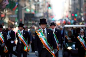 NEW YORK, NY - MARCH 17:  Participants march in the annual St. Patrick's Day parade, one of the largest and oldest in the world on March 17, 2016 in New York City. Now that a ban on openly gay groups has been dropped, New York Mayor Bill de Blasio is attending the parade for the first time since he became mayor in 2014. The parade goes up Fifth Avenue ending at East 79th Street and will draw an estimated 2 million spectators along its 35-block stretch.  (Photo by Spencer Platt/Getty Images)