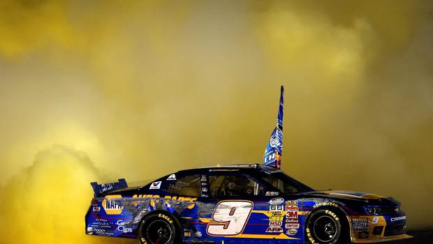 Chase Elliott, driver of the #9 NAPA Auto Parts Chevrolet, celebrates winning the series championship with a burnout during the NASCAR Nationwide Series Ford EcoBoost 300 at Homestead-Miami Speedway on November 15, 2014 in Homestead, Florida.  (Photo by Patrick Smith/Getty Images)